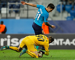 November 23, 2017 - Saint Petersburg, Russia - Sebastian Driussi (top) of FC Zenit Saint Petersburg and Filip Gachevski of FK Vardar vie for the ball during the UEFA Europa League Group L match between FC Zenit St. Petersburg and FK Vardar at Saint Petersburg Stadium on November 23, 2017 in Saint Petersburg, Russia. (Credit Image: © Mike Kireev/NurPhoto via ZUMA Press)
