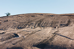 Hikers on Enchanted Rock,  Enchanted Rock State Natural Area, near Fredericksburg, Texas in the Texas Hill Country, USA.