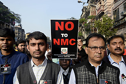 January 2, 2018 - Kolkata, West Bengal, India - Doctors and Medical students rallied with poster against National Medical Commission bill in Kolkata. Doctors of Indian Medical Association (IMA) and medical student participate in a rally to protest against National Medical Commission (NMC) bill on January 02, 2017 in Kolkata. (Credit Image: © Saikat Paul/Pacific Press via ZUMA Wire)