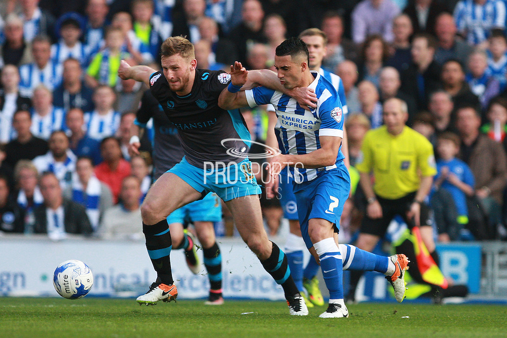 Sheffield Wednesday defender Tom Lees & Brighton central midfielder Beram Kayal tussle for possession during the Sky Bet Championship play-off second leg match between Brighton and Hove Albion and Sheffield Wednesday at the American Express Community Stadium, Brighton and Hove, England on 16 May 2016. Photo by Bennett Dean.