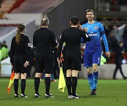 07 January 2018 FA Cup 3rd round Nottingham - Nottingham Forest v Arsenal - Per Mertesacker of Arsenal confronts referee Jonathan Moss and his assistants after the final whistle.<br /> (photo by Mark Leech)