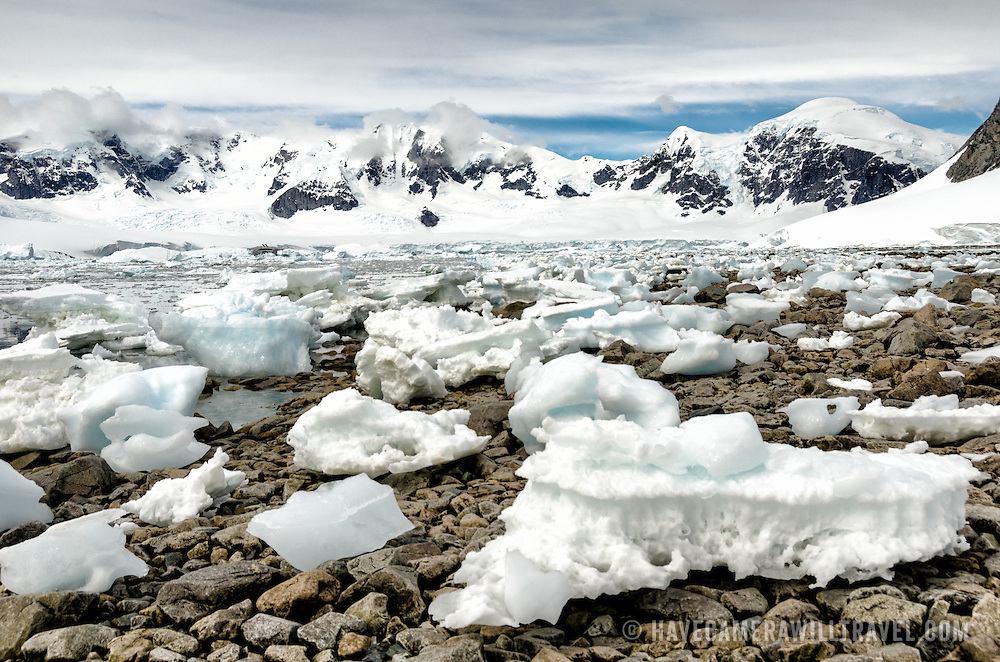 Small blocks of ice washed ashore on the rocky beach at Cuverville Island in the Antarctic Peninsula.