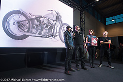 LowRide Magazine editor Giuseppe Roncen presents awards at the LowRide bike show as the winning bikes are displayed on-screen during Motor Bike Expo. Verona, Italy. Sunday January 22, 2017. Photography ©2017 Michael Lichter.