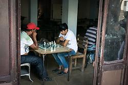 18 September 2015, Cienfuegos, Cuba: Young men play chess at a cafe in Cienfuegos.