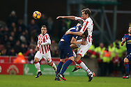 Peter Crouch of Stoke city is blocked by Phil Jones of Manchester Utd. Premier league match, Stoke City v Manchester Utd at the Bet365 Stadium in Stoke on Trent, Staffs on Saturday 21st January 2017.<br /> pic by Andrew Orchard, Andrew Orchard sports photography.