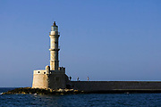 Lighthouse in the old, Venetian harbour at Chania, Crete, Greece