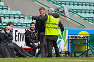 RED CARD A safety officer shows Motherwell FC manager Graham Alexander to the stand, after the manager was shown a red card by referee Alan Muir during the SPFL Premiership match between Hibernian FC and Motherwell FC at Easter Road, Edinburgh, Scotland on 27 February 2021.