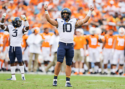 Sep 1, 2018; Charlotte, NC, USA; West Virginia Mountaineers linebacker Dylan Tonkery (10) signals a play before a snap during the third quarter against the Tennessee Volunteers at Bank of America Stadium. Mandatory Credit: Ben Queen-USA TODAY Sports