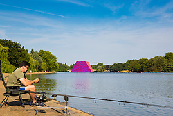 An angler enjoys the morning sunshine beside the Serpentine in Hyde Park as another heatwave day begins with temperatures expected to soar. London, July 01 2018.