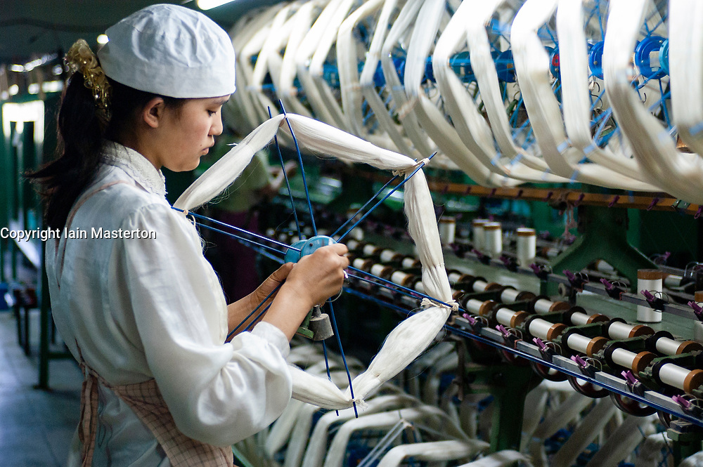 Female Uyghur woman working in silk factory in Xinjiang province China
