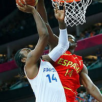 08 August 2012: Ronny Turiaf layup is rejected by Serge Ibaka during 66-59 Team Spain victory over Team France, during the men's basketball quarter-finals, at the 02 Arena, in London, Great Britain.