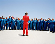 In the mid-day heat, Squadron Leader Spike Jepson, leader of the elite 'Red Arrows', Britain's prestigious Royal Air Force aerobatic team, informally addresses the team's highly-skilled ground crew at RAF Akrotiri, Cyprus after the whole team's success of passing PDA (or 'Public Display Authority'). The Red Arrows are then allowed by senior RAF officers to perform as a military aerobatic show in front of the general public - following a special test flight when their every move and mistake is assessed and graded. Until that day arrives, their training and practicing is done in the privacy of their own airfield at RAF Scampton in Lincolnshire, UK. Squadron Leader Jepson has gathered his engineers and support crew known as the Blues to congratulate and encourage them. Specialists like these outnumber the pilots 8:1 and without them, the Red Arrows couldn't fly.