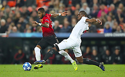 Manchester United's Fred (left) and Valencia's Geoffrey Kondogbia battle for the ball