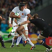 Richie McCaw, New Zealand moves in to tackle Thierry Dusautoir, France,  in action during the New Zealand V France Final at the IRB Rugby World Cup tournament, Eden Park, Auckland, New Zealand. 23rd October 2011. Photo Tim Clayton...