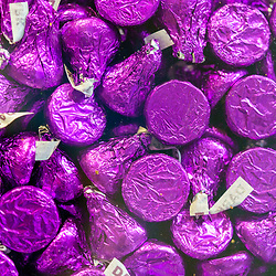 Hershey, PA USA - November 26, 2019:  Purple foil wrapped Hershey Special Dark Chocolate Kisses on display in Chocolate World.
