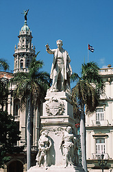 Statue of Cuban national hero Jose Marti in Parque Central in front of the Gran Teatro and Hotel Inglaterra,