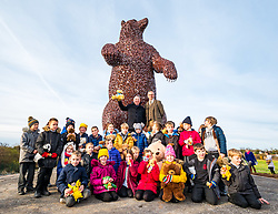 Dunbar, East Lothian, Scotland, United Kingdom, 19 November 2019. Andy Scott statue unveiling: Unveiling today of a 5m high bear sculpture to celebrate the life of naturalist John Muir. The sculpture by the Kelpies creator Andy Scott marks Dunbar-born John Muir who played a key role in the development of national parks in the US. Pictured: Ken Ross (Hallhill Developments), Andy Scott (sculptor) and children from Primary 4 at Dunbar Primary School.<br /> Sally Anderson   EdinburghElitemedia.co.uk