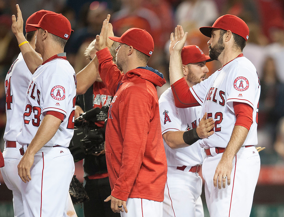 The Angels' Matt Shoemaker, at right, high-fives teammates after the Angels' 7-2 victory against the Houston Astros Friday night at Angel Stadium. <br /> <br /> ///ADDITIONAL INFO:   <br /> <br /> angels.0528.kjs  ---  Photo by KEVIN SULLIVAN / Orange County Register  -- 5/27/16<br /> <br /> The Los Angeles Angels take on the Houston Astros Friday at Angel Stadium.