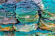 Fishing nets folded and ready to go at An Bang Beach, Hoi An, Vietnam. They go out in round basket boats and fish at night and clean and fold for next trip. RAW to Jpg