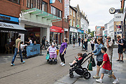 Shoppers come and go between high street shops on 27th July 2021 in Maidenhead, United Kingdom. Many independent high street businesses are believed to be facing closure after having taken on much higher multiples of debt during the Covid-19 pandemic in order to survive.