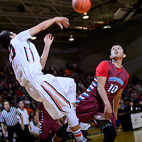 010915  Adron Gardner/Independent<br /> <br /> Gallup Bengal Ronald Lee (20) saves a ball from out-of-bounds with a throw over Shiprock Chieftain Deron Johnson (10) during the Gallup Invitational Basketball Tournament at Gallup High School Friday.