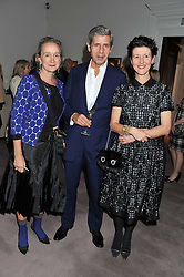Left to right, LUCINDA CHAMBERS, SIR STUART ROSE and MELANIE CLORE at a party to celebrate the publication of Can We Still Be Friends by Alexandra Shulman held at Sotheby's, 34-35 New Bond street, London on 28th March 2012.