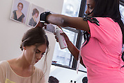 A model gets her hair done backstage at the Carmen Marc Valvo Spring 2013 show at Fashion Week.
