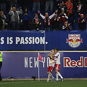 Dax McCarty, (left), New York Red Bulls, is congratulated by team mate Ruben Bover Izquierdo, after scoring a goal  during the New York Red Bulls Vs Toronto FC, Major League Soccer regular season match at Red Bull Arena, Harrison, New Jersey. USA. 11th October 2014. Photo Tim Clayton