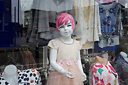 A mannequin of a childs size is seen in the wondow of a clothing business in Barking, on 8th October 2019, in Barking, Essex, England.