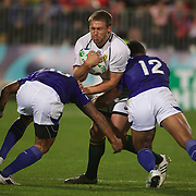 Francois Steyn, South Africa, is tackled by Tusi Pisi, (left) and Eliota Fuimaono Sapolu, Samoa, during the South Africa V Samoa, Pool D match during the IRB Rugby World Cup tournament. North Harbour Stadium, Auckland, New Zealand, 30th September 2011. Photo Tim Clayton...