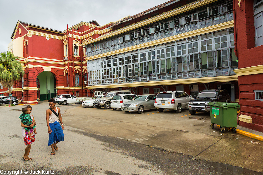 07 JUNE 2014 - YANGON, MYANMAR: The main wing of the Yangon General Hospital. Yangon General Hospital is the largest hospital in Myanmar. It was opened in 1899 when Myanmar was the British colony of Burma. The main buildings, built in the Victorian style, were built in 1905. Yangon has the highest concentration of colonial style buildings still standing in Asia. Efforts are being made to preserve the buildings but many are in poor condition and not salvageable.    PHOTO BY JACK KURTZ