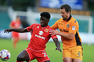 Kabongo Tshimanga of Milton Keynes Dons (l) holds off Darren Jones of Newport county ®. EFL cup, 1st round match, Newport county v Milton Keynes Dons at Rodney Parade in Newport, South Wales on Tuesday 9th August 2016.<br /> pic by Andrew Orchard, Andrew Orchard sports photography.