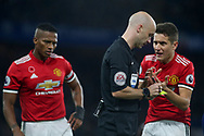 Manchester United midfielder Andre Herrera ® pleads with the referee Anthony Taylor. Premier league match, Chelsea v Manchester United at Stamford Bridge in London on Sunday 5th November 2017.<br /> pic by Kieran Clarke, Andrew Orchard sports photography.