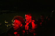 Micah Walthall, 14, left, and Bryan Carson, 15, have the time of their life during the night time excursion.