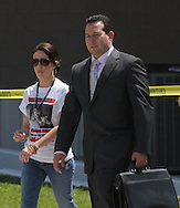 Casey Anthony, mother of missing three-year-old Caylee Anthony, is escorted by her attorney Jose Baez to turn herself into jail for additional economic charges after meeting with her home confinement officer for other charges at the Orange County Jail Monday, Sept. 15, 2008.  Anthony is on home confinement for charges relating to the disappearance of her daughter.