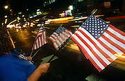 American flags re on sale at night in the streets of Manhattan, only days after the attacks on New York's twin towers