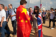 London, UK. Thursday 9th August 2012. London 2012 Olympic Games Park in Stratford. Two people share the flags of their nations, China and Great Britain.