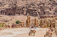 Petra, Jordan - May 10, 2013: tourists visiting The Hadrien Gate roman avenue in Petra Jordan on may 10th, 2013