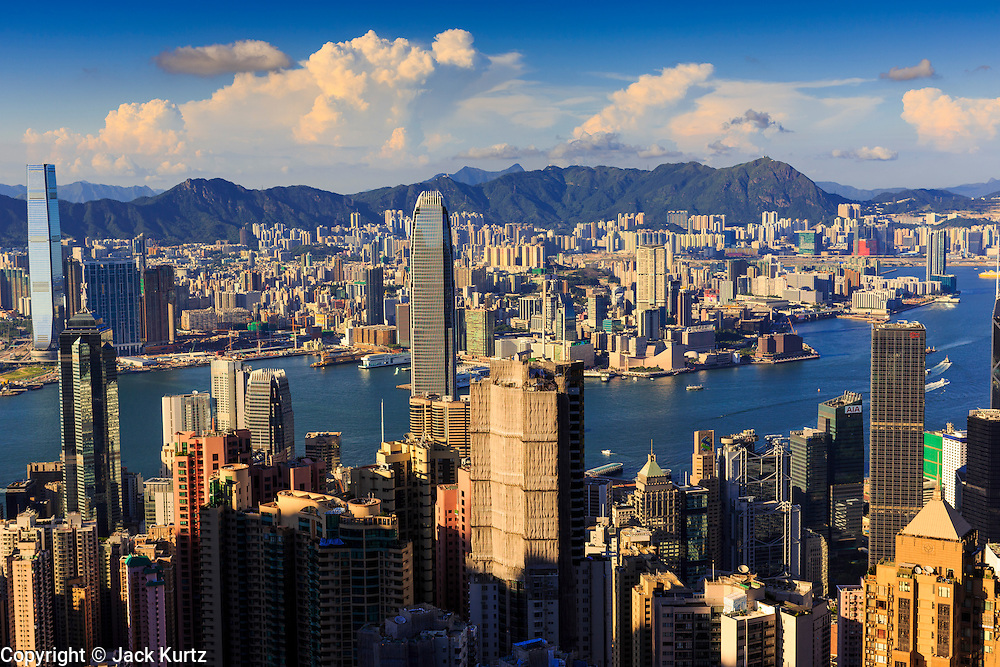 11 AUGUST 2013 - HONG KONG: Looking across to Kowloon from Victoria Peak in Hong Kong. Hong Kong is one of the two Special Administrative Regions of the People's Republic of China, Macau is the other. It is situated on China's south coast and, enclosed by the Pearl River Delta and South China Sea, it is known for its skyline and deep natural harbour. Hong Kong is one of the most densely populated areas in the world, the  population is 93.6% ethnic Chinese and 6.4% from other groups. The Han Chinese majority originate mainly from the cities of Guangzhou and Taishan in the neighbouring Guangdong province.      PHOTO BY JACK KURTZ