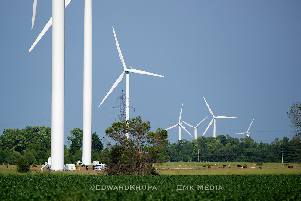 Technicians provide a sense of scale. Here servicing a huge (80m) wind turbine on a farm in Bruce County Ontario, Canada. Part of the Enbridge Ontario Wind Farm