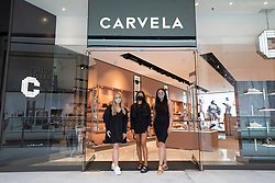 Edinburgh, Scotland, UK. 24 June 2021. First images of the new St James Quarter which opened this morning in Edinburgh. The large retail and residential complex replaced the St James Centre which occupied the site for many years. Pic; Staff at Carvela pose after opening doors for the first time. Iain Masterton/Alamy Live News