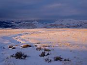 Setting sun following departing storm illuminating Macon Flat below the Smoky Mountains east of Fairfield, Idaho.