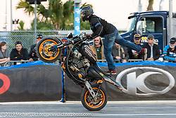 The Ill Conduct Stunt Team performs on the break of the American Flat Track TT at Daytona International Speedway during Daytona Bike Week. Daytona Beach, FL. USA. Thursday March 15, 2018. Photography ©2018 Michael Lichter.