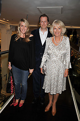 Left to right, LAURA LOPES, TOM PARKER BOWLES and their mother HRH the DUCHESS OF CORNWALL at the launch of Tom Parker Bowles's new book 'Full English' held in the Gallery Restaurant, Selfridges, Oxford Street, London on 9th September 2009.