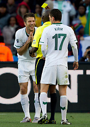 Bostjan Cesar of Slovenia and referee Koman Coulibaly (MLI) with yellow card during the 2010 FIFA World Cup South Africa Group C match between Slovenia and USA at Ellis Park Stadium on June 18, 2010 in Johannesberg, South Africa. (Photo by Vid Ponikvar / Sportida)
