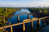 Two trains on the railroad trestles over the Congaree River in Columbia, SC, by photographer Jeff Blake, www.JeffBlakePhoto.com
