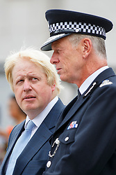 © Licensed to London News Pictures. 03/08/2015. London, UK. Mayor of London, Boris Johnson and Metropolitan Police Commissioner Bernard Hogan-Howe attend a parade for the capital's young police volunteers in Trafalgar Square, London on Monday, August 3, 2015. Photo credit: Tolga Akmen/LNP
