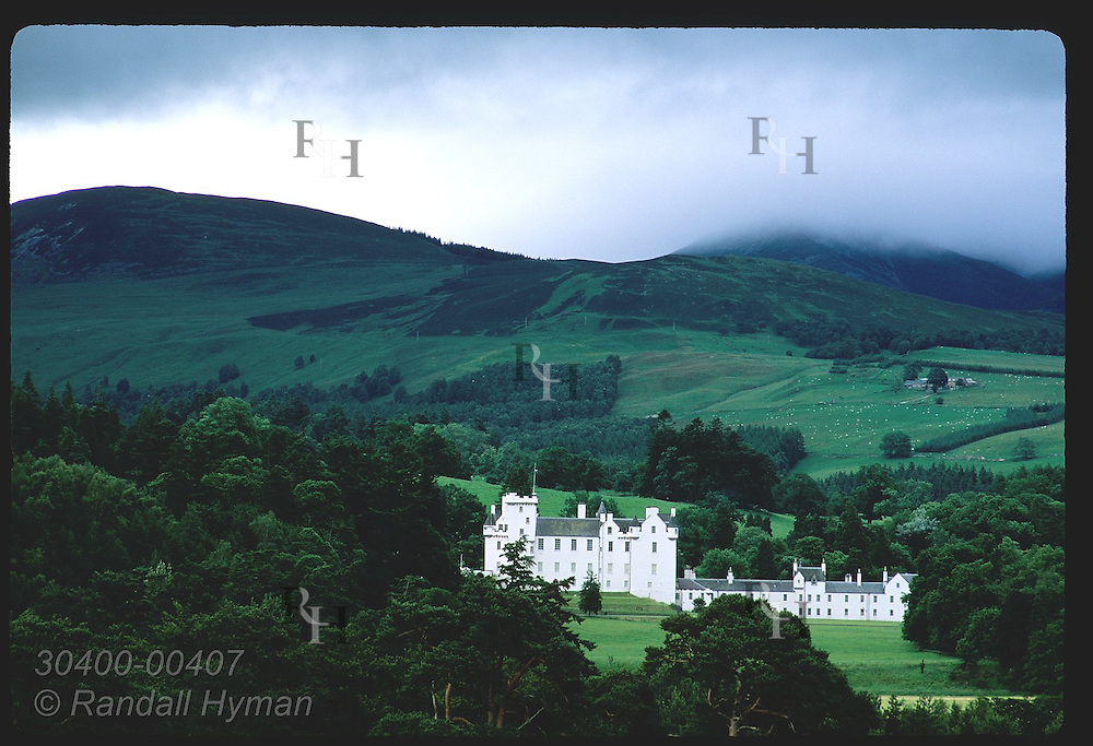 Blair Castle nestles in the rolling hills of the Highlands on a stormy summer day; Pitlochry. Scotland