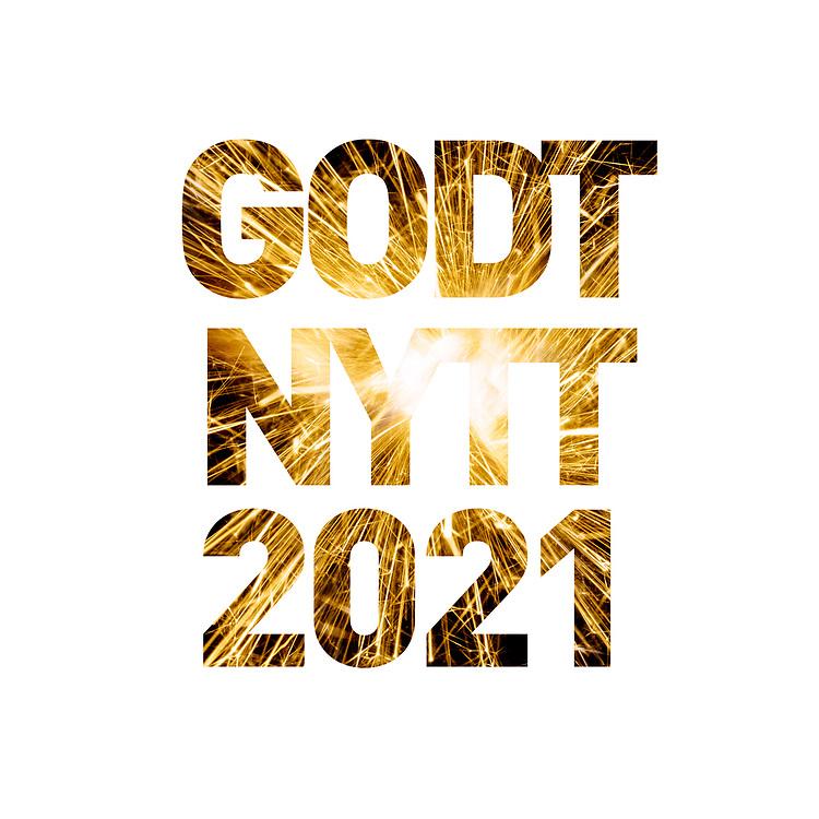 Nyttårshilsen i form av fyrverkeribilde i teksten «Godt nytt 2021».