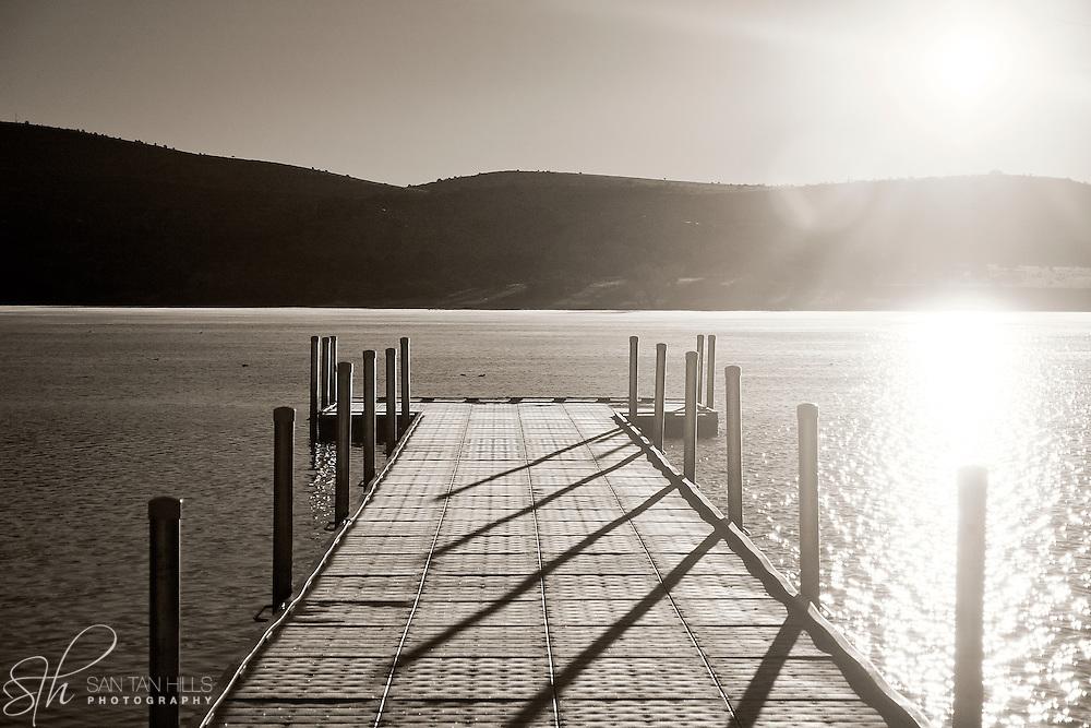 A dock extending out on Watson Lake at sunrise - Prescott, AZ